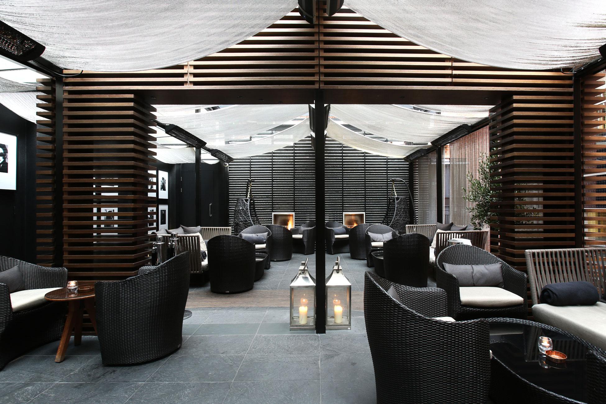 Hotel photography, bar + rattan furniture